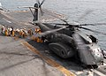 US Navy 030509-N-2382W-037 Members of Combat Cargo unload mail from a MH-53E Sea Dragon.jpg