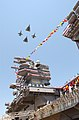 US Navy 030712-N-8295E-462 Aircraft fly over the newest Nimitz-class aircraft carrier, USS Ronald Reagan (CVN 76), in diamond formation at the conclusion of the commissioning ceremony for the ship.jpg
