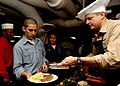 US Navy 040411-N-6278K-052 Capt. Dee Mewbourne, Executive Officer, USS George Washington (CVN 73), serves crew members Easter dinner in the ship's galley.jpg