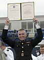 US Navy 040528-N-9693M-020 Newly commissioned 2nd Lt. Aaron Tyler displays his degree to family and friends in the crowd during the U.S. Naval Academy class of 2004 graduation and commissioning ceremony.jpg