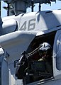 US Navy 040620-N-6208N-001 Aviation Structural Mechanic 3rd Class Nick Tookenay, from Jacksonville, Fla., mans the gun mount on a MH-60S Knighthawk helicopter.jpg