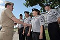 US Navy 050225-N-3228G-001 Master Chief Petty Officer of the Navy (MCPON) Terry Scott meets several Task Force Uniform volunteers.jpg