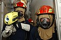 US Navy 050418-N-5526M-016 Firefighters stationed aboard guided missile destroyer USS Mustin (DDG 89), cautiously enter a space suspected of containing an electrical fire.jpg
