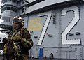 US Navy 050613-N-5384B-025 A Plane Captain stands by on the flight deck aboard the Nimitz-class aircraft carrier USS Abraham Lincoln (CVN 72).jpg