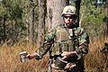 US Navy 050623-N-6551H-014 A member of Explosive Ordnance Disposal Mobile Unit Five (EODMU-5) carries a hydrojet water disrupter to the roadside command post during Exercise Talisman Sabre 2005.jpg