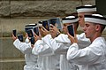 US Navy 050629-N-9693M-184 First day Midshipmen stand at attention while reading Reef Points, the manual for Midshipmen at the United States Naval Academy in Annapolis, Md.jpg