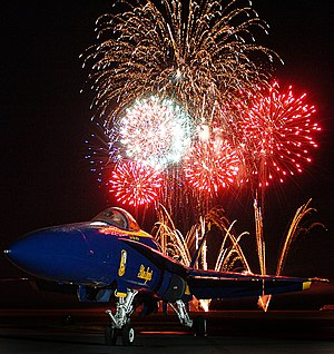 Millington-Memphis Airport - Image: US Navy 050931 N 9769P 001 Fireworks explode and highlight an F A 18A Hornet, assigned to the U.S. Navy flight demonstration team, the Blue Angels, at the Mid South Air Show at the Millington Municipal Airport