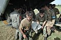 US Navy 051014-N-8796S-189 Pakistani soldiers carry an injured woman off of a U.S. Navy MH-53E Sea Stallion helicopter in Chaklala, Pakistan.jpg
