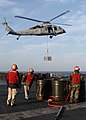 US Navy 060128-N-9805F-001 Weapons Department personnel standby during a vertical replenishment at sea.jpg