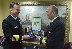 US Navy 060214-N-2383B-120 Chief of Naval Operations (CNO) Adm. Mike Mullen, left, exchange plaques with Royal Norwegian Navy Chief of Staff, Rear Adm. Jan Eirik Finseth.jpg