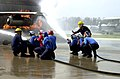 US Navy 060222-7750K-N-139 Air Department instructors onboard Naval Air Technical Training Center (NATTC), train a group of students on the proper way to extinguish a fire.jpg