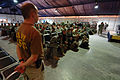 US Navy 061223-N-5758H-062 Operations Specialist 3rd Class Joseph Watson, assigned to Navy Customs Battalion Romeo, prepares to brief troops redeploying about items that are prohibited.jpg