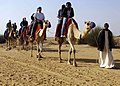 US Navy 061224-N-5330L-069 Sailors from the Nimitz-class aircraft carrier USS Dwight D. Eisenhower (CVN 69) take the opportunity to ride a camel during a Morale Welfare and Recreation sponsored tour.jpg