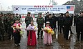 US Navy 070324-N-4207M-002 Republic of Korea navy and marine forces wait with children wearing traditional Korean garments to welcome amphibious assault ship USS Essex (LHD 2) during exercise Foal Eagle 2007.jpg
