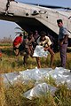 US Navy 071127-N-5642P-135 Local residents assist in unloading bags of fresh water from a CH-53E Sea Stallion helicopter attached to Marine Medium Helicopter Squadron (HMM) 261.jpg