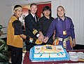 US Navy 071130-N-5121R-006 Capt. Ted Carter, commanding officer of the nuclear-powered aircraft carrier USS Carl Vinson, assists Sailors in cutting a cake during the ship's American Indian and Alaskan Native Heritage.jpg