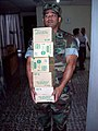 US Navy 071214-N-2398S-073 Storekeeper 1st Class Vince Magalit, from Forward Operating Location Comalapa, carries medical supplies to storage during a community relations project at the Iglesia Nazarret free clinic in San Salva.jpg
