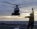US Navy 080219-N-4010S-245 A landing signal officer directs a helicopter to the flight deck of the amphibious assault ship USS Essex (LHD 2).jpg