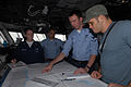 US Navy 080911-N-1635S-001 Quartermaster 3rd Class Christopher Bridges describes his job to Ultimate Fighting Championship (UFC) fighter Rich Franklin on the bridge of the Nimitz-class aircraft carrier USS Ronald Reagan (CVN 76.jpg