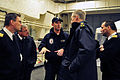 US Navy 081121-N-5758H-331 Lt. Cmdr. Rich Jarrett explains features of the hangar bay aboard the littoral combat ship USS Freedom (LCS 1) to Canadian navy personnel during a tour of the ship's spaces.jpg