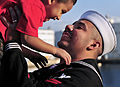 US Navy 081202-N-0807W-488 Hospital Corpsman 2nd Class Arturo J. Adame holds his son during a homecoming celebration for the amphibious transport dock ship USS Denver (LPD 9)to Fleet Activities Sasebo.jpg