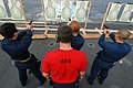 US Navy 090121-N-1688B-053 Gunner's Mate 1st Class Benjamin West gives orders to Sailors during a 9mm weapons qualification.jpg