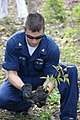 US Navy 090429-N-1004S-185 Engineman 3rd Class Marc Deskin, embarked aboard the Military Sealift Command hospital ship USNS Comfort (T-AH 20) plants a tree during a Continuing Promise 2009 community service project.jpg