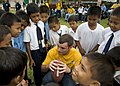 US Navy 090624-N-1722M-483 Fire Controlmen 1st Class Wesley D. Pruitt, assigned to the guided-missile destroyer USS Chung-Hoon (DDG 93), huddles with Malaysian students while playing American football.jpg