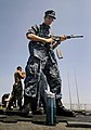 US Navy 090930-N-5345W-305 Operations Specialist 2nd Class Jeremy Sotomayor ejects an empty magazine from his M-4 assault rifle during a weapons qualification exercise on the flight deck of the amphibious dock landing ship USS.jpg