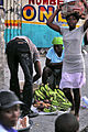 US Navy 100121-N-6006S-050 Haitian citizens attempt to regain a measure of normalcy in the aftermath of the recent earthquake while U.S. service members continue their efforts to provide assistance.jpg