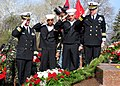 US Navy 100410-N-0000X-001 Cmdr. Mike Ruhsenburger , Boatswain's Mate 3rd Class Michael Horne, and Cmdr. Hermann Pfaeffle lay a wreath on the Tomb of the Unknown Sailor.jpg