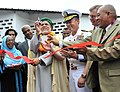 US Navy 100511-N-9187B-018 Rear Adm. Brian L. Losey, commander of Combined Joint Task Force-Horn of Africa, center right, and Comorian President Ahmed Abdallan Mohamed Sambi, center left, cut a ceremonial ribbon at the Hamramba.jpg