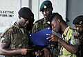 US Navy 100514-N-4971L-083 Members of the Jamaica Defense Force show off their certificates of participation for a weeklong Naval Criminal Investigative Service (NCIS) port security subject matter expert exchange.jpg