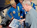US Navy 100516-N-8732C-299 Cmdr. Greg McWherter presents Secretary of the Navy Ray Mabus an autographed memento of the Blue Angels flight demonstration team in flight.jpg
