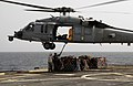 US Navy 100815-N-9706M-578 Marines attach a pendant to the bottom of an MH-60S Sea Hawk helicopter during a vertical replenishment.jpg