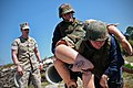 US Navy 110317-N-YR391-007 Hospital corpsmen assigned to Naval Hospital Jacksonville maneuver through an obstacle course while carrying a training.jpg