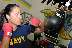 Punching bag - Woman working out with a speed bag