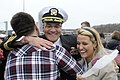 US Navy 110408-N-8467N-007 Cmdr. Raymond Gabriel hugs his son and daughter after returning form deployment.jpg