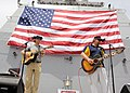 US Navy 110424-N-BZ392-581 Country music entertainer Toby Keith, right, and Scotty Emerick, left, perform an Easter USO concert aboard the guided-m.jpg