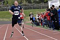 US Navy 110517-N-CD297-015 Team Navy-Coast Guard member Lt. Daniel B. Cnossen runs the 800-meter during the second annual Warrior Games.jpg