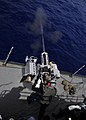 US Navy 110719-N-BK435-072 Gunner's Mate 2nd Class Patrick Boettger, assigned to the submarine tender USS Frank Cable (AS 40), fires a Mark 38 25mm.jpg