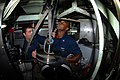 US Navy 110810-N-NK458-010 Machinist's Mate 1st Class Corey Harris, right, and Machinist's Mate 3rd Class Rick Murphy lower a piston into the exter.jpg