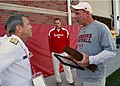 US Navy 110906-N-CI293-159 Rear Adm. Douglas J. McAneny, commandant of the National War College, presents University of Nebraska Head Football Coac.jpg