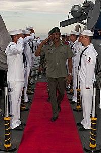 US Navy 111127-N-ER662-545 Sideboys render honors to Brig. Gen. Filomeno da Paixao de Jesus, Deputy Chief of Defense Force for Timor-Leste, aboard