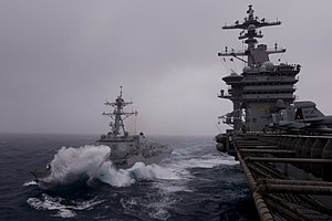 US Navy 111226-N-TZ605-830 USS Halsey and USS Carl Vinson cruise together during a refueling at sea.jpg