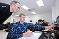US Navy 120119-N-GS507-177 A Sailor demonstrates to Chief of Naval Personnel Vice Adm. Scott R. Van Buskirk how his computer responds to his method.jpg