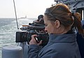 US Navy 120214-N-VY256-020 NBC News producer Courtney Kube records the view outside the pilothouse of the Ticonderoga-class guided-missile cruiser.jpg
