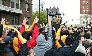 VCU Rams men's basketball - Students celebrate VCU's upset victory over Kansas. The win gave VCU a berth into the Final Four.