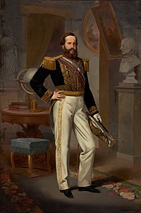 Full-length painted portrait of a young, full-bearded man standing before a table on which are books and a globe and wearing white trousers, a military tunic with heavy gold braid, a sash of office, and holding a bicorn admiral's hat