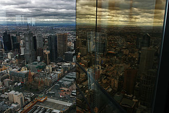 Eureka Tower - Looking north-east over Melbourne CBD from Skydeck 88, with reflections in the tower's gold plated windows